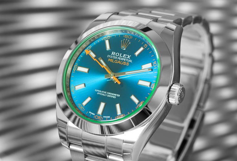Silver Rolex Milgaus 116400GV Z-Blue with blue dial and grey background