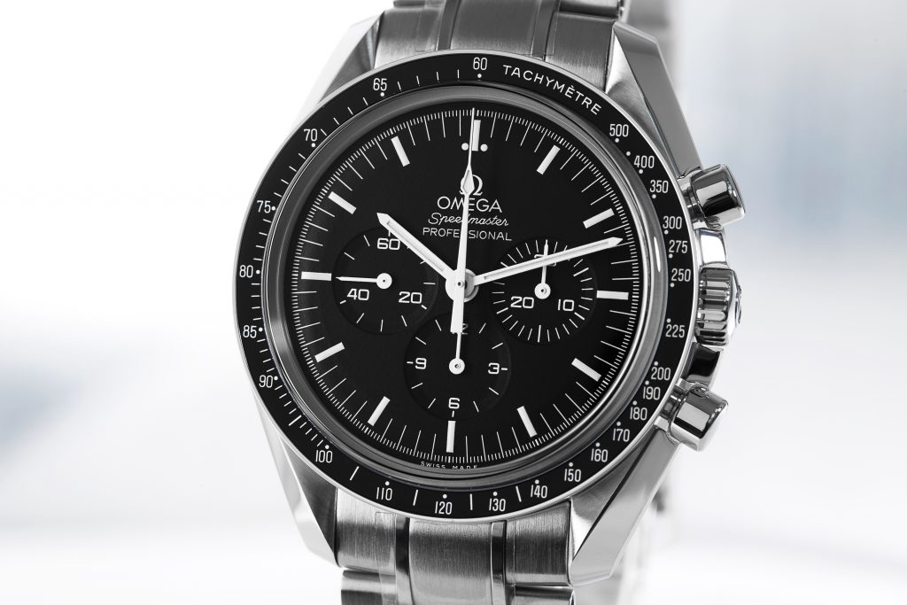 Omega Speedmaster Moonwatch Professional watch on grey background