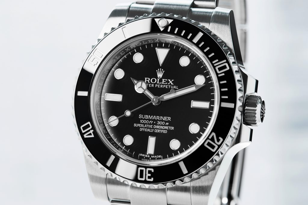 Rolex Submariner No Date watch reference 114060 on grey background