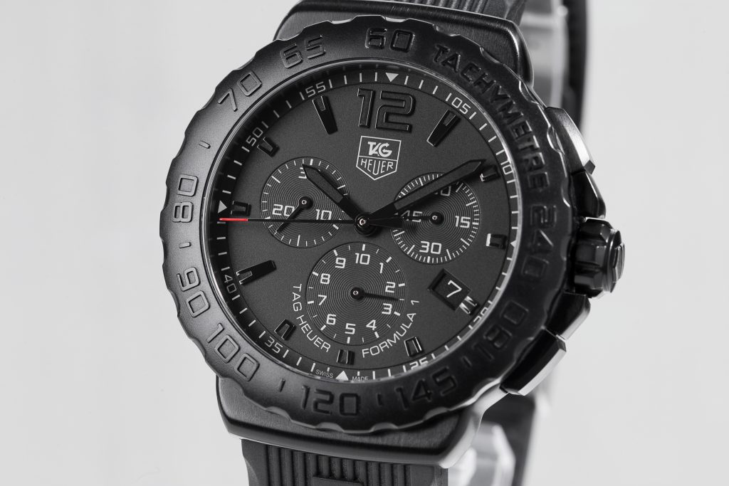 Close-up of a TAG Heuer Formula 1 watch on white background