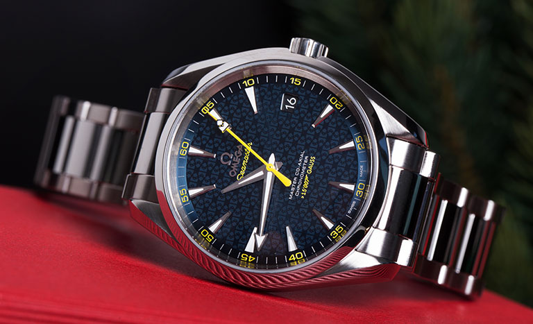 Omega Seamaster Aqua Terra 150 M 231.10.42.21.03.004 stainless steel watch with blue dial on red table