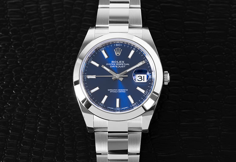 Rolex Datejust 126300 with blue dial on black background