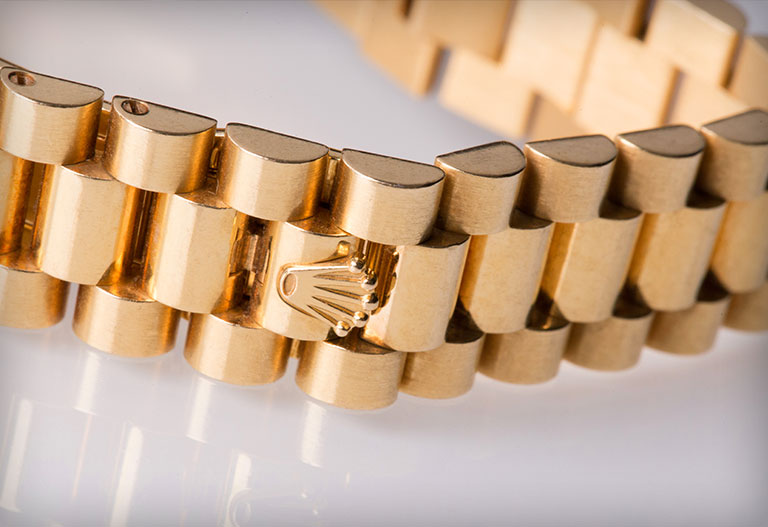 Rolex President bracelet in yellow gold
