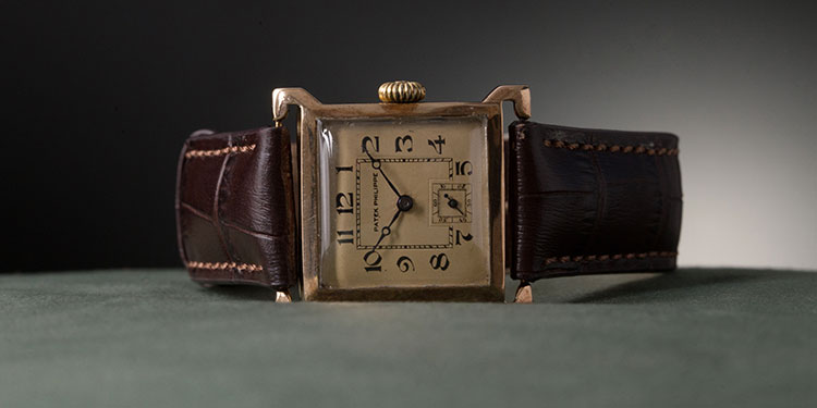 A Patek Philippe watch with a leather bracelet