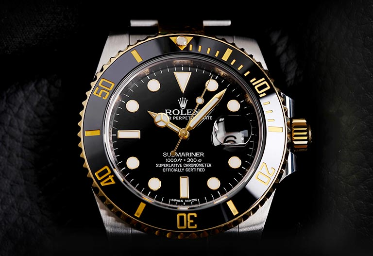 Detail of a Rolex Submariner Ref. 116613BKSO dial and case with black background