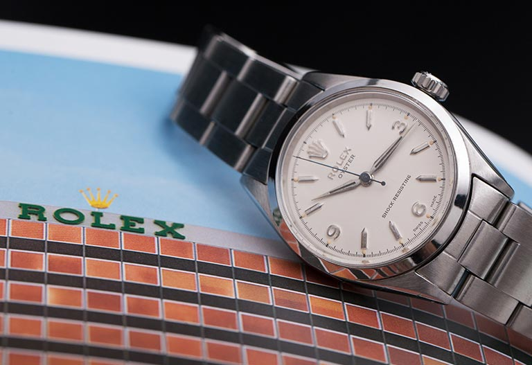 Rolex Oyster 6246 lying on Rolex magazine