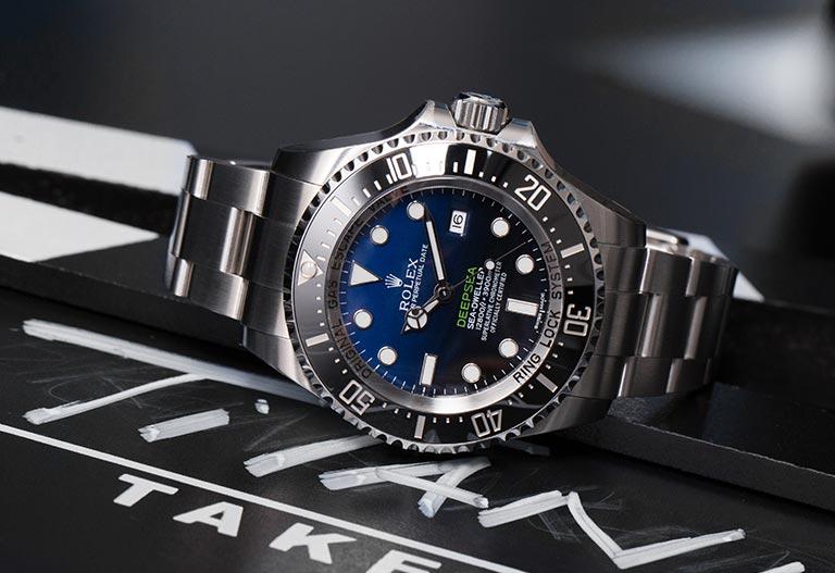 Rolex Sea-Dweller Deepsea D-Blue 116660 James Cameron Edition lying on a film flap