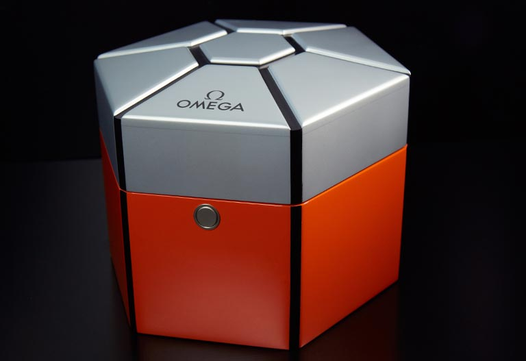 A fancy red and grey Omega box