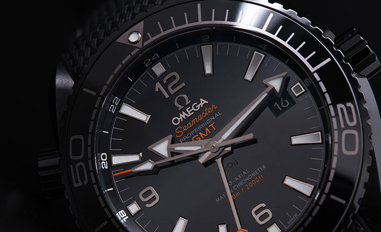 Black dial of a Omega Seamaster Planet Ocean 600 M 215.92.46.22.01.001 diver's watch with orange colour highlights