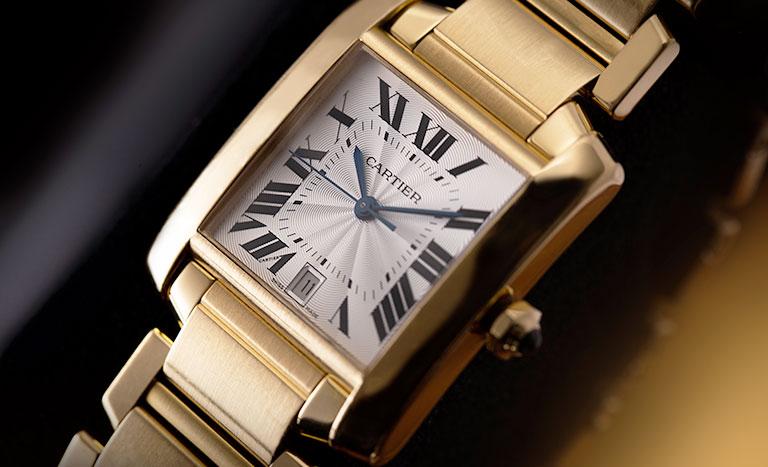 A full golden Cartier Tank Francaise watch ref. W50001R2 1840