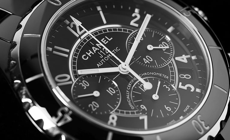 The dial of a Chanel J12 watch in close-up
