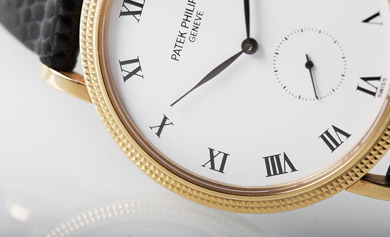 Patek Philippe Calatrava watch with a leather strap on a white background
