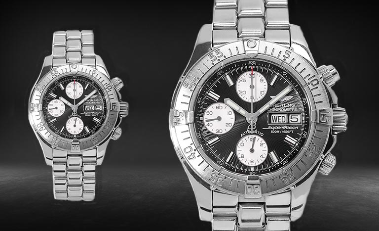 Two identical Breitling Superocean Chronograph A13340 watches on a black and grey background