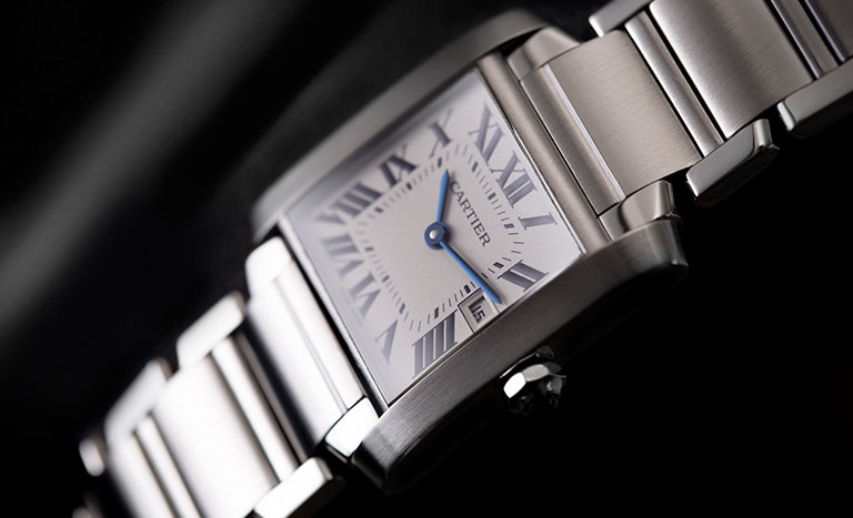 A Cartier Tank Francaise watch wih black background