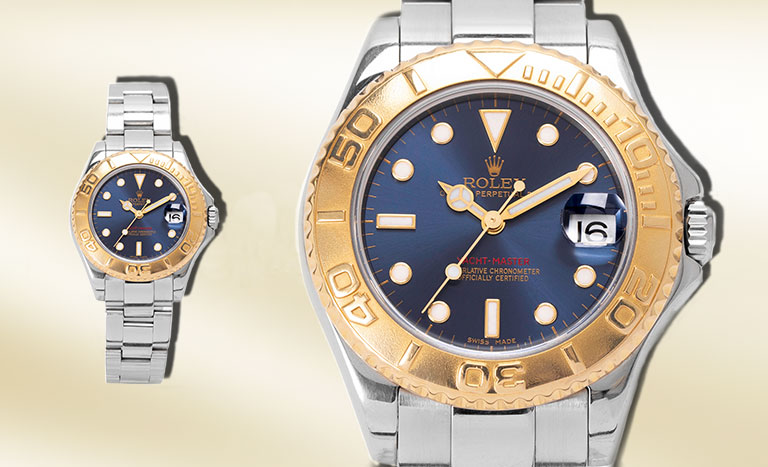 Two identical Rolex Yacht-Master watches on a champagne background