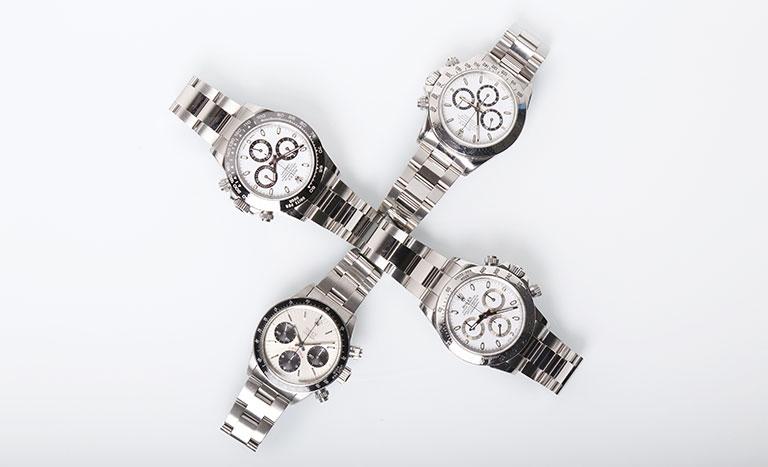Vier Rolex Daytona Edelstahl-Uhren