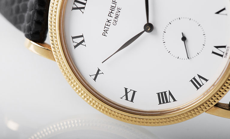 The white dial of a Patek Philippe Calatrava