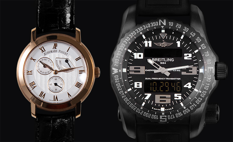 Audemars Piguet Jules Audemars 25955OR.OO.D002CR.01 and Breitling Emergency V76325G1.BC46 watches on black background