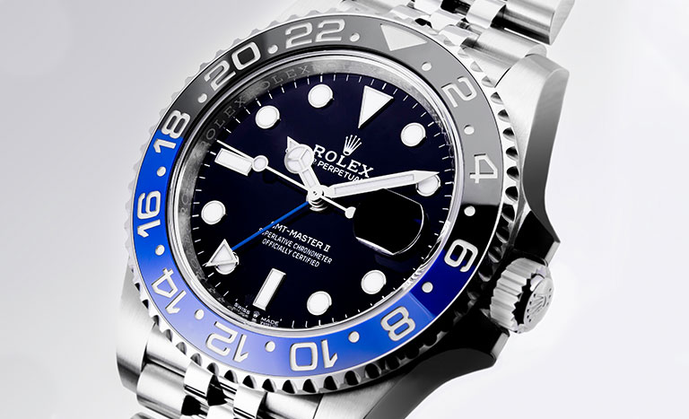 Rolex GMT-Master II 126710BLNR watch with black and blue lunette and grey background
