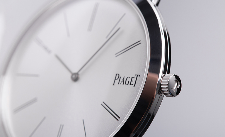 Dial of a Piaget Altiplano watch with grey background
