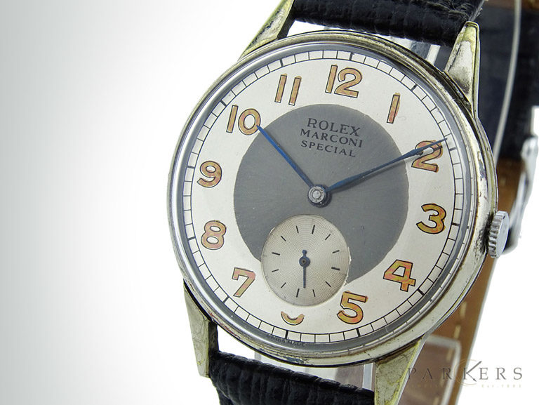 White and grey dial of a Rolex Marconi watch with black leather strap