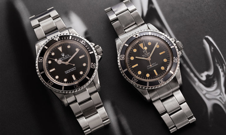 Rolex Submariner 5513 next to Tudor Submariner 7016/0 steel watch with black dial