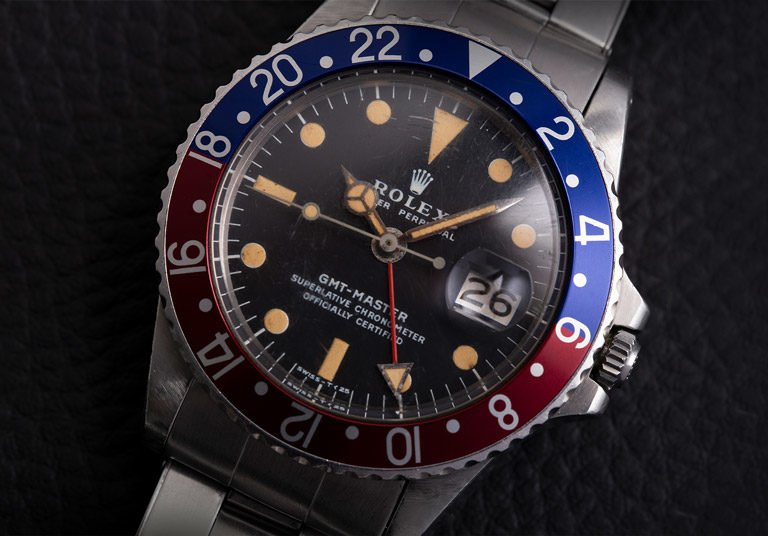 Pre-owned Rolex GMT-Master 1675 watch with black dial and Pepsi bezel