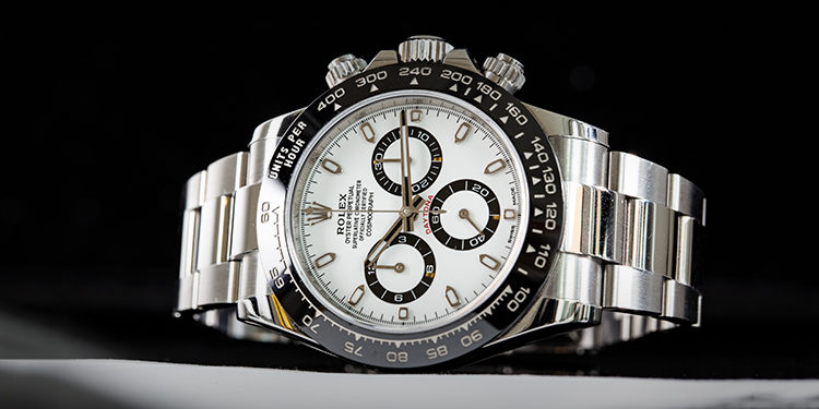 Second-hand Rolex Cosmograph Daytona 116500LN watch lying on a black background