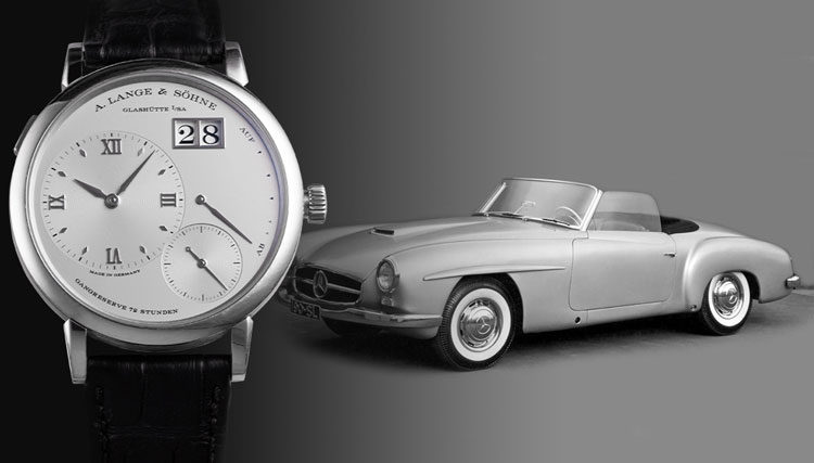 White gold A. Lange & Söhne Grand Lange 1 117.025 watch with silver Mercedes Benz 190 S W121 in the background
