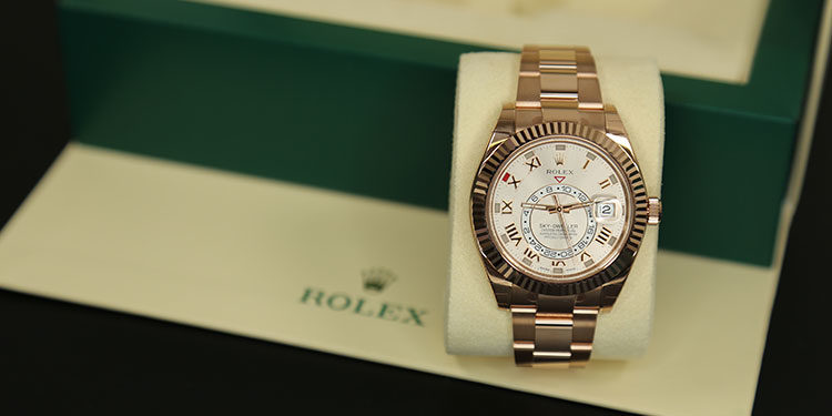 Rolex Sky-Dweller watch with watch box in the background