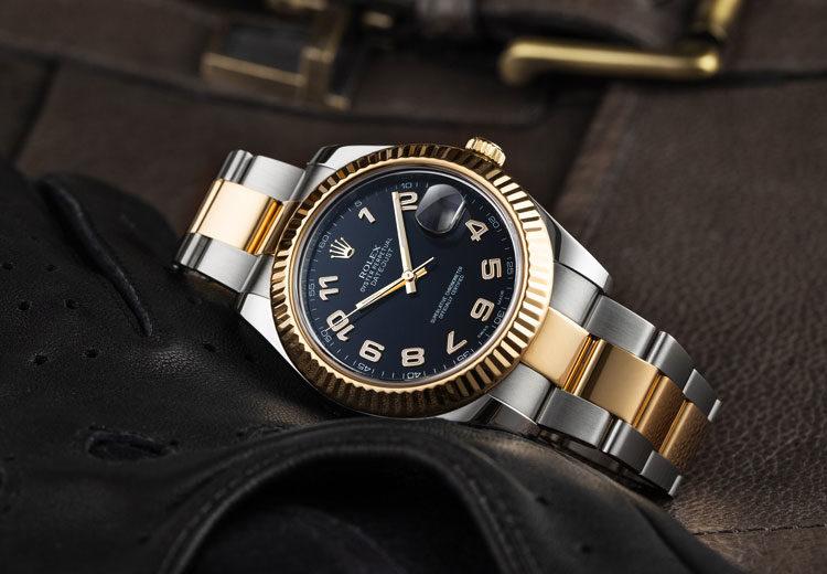 Rolex Datejust II 116333 two-tone men's luxury watch lying on black leather glove
