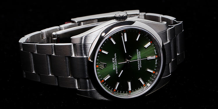 Rolex Oyster Perpetual 114200 green dial