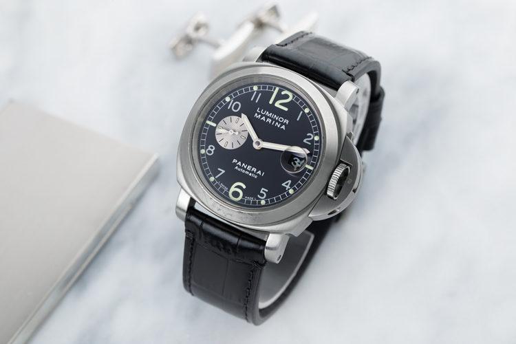 Panerai Luminor Marina PAM00086 men's watch with black dial on light marble
